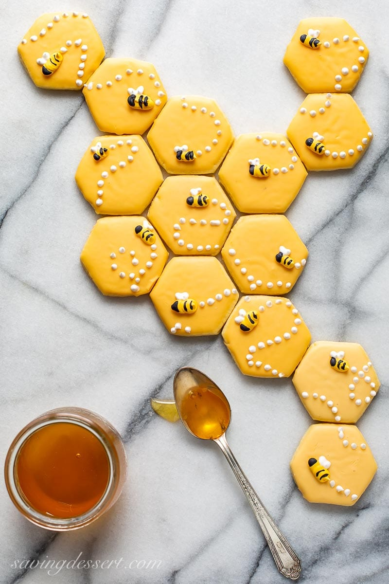 A honeycomb pattern made with a cut-out sugar cookie recipe decorated with honey bees on top