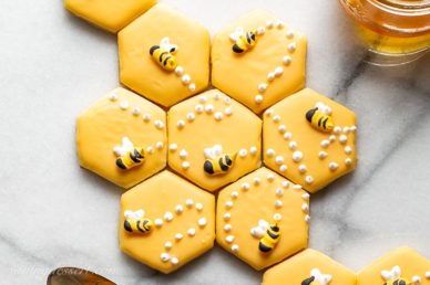 Cut out sugar cookies decorated with honey bees