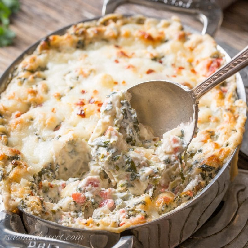 a casserole dish with hot Southwestern Spinach Dip