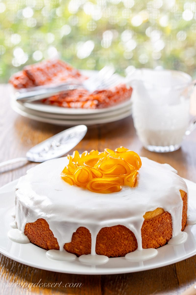A one layer Sunny Citrus Cake topped with a simple icing and candied orange slices
