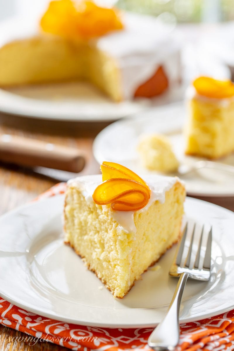 A slice of Sunny Citrus Cake with a candied orange on top
