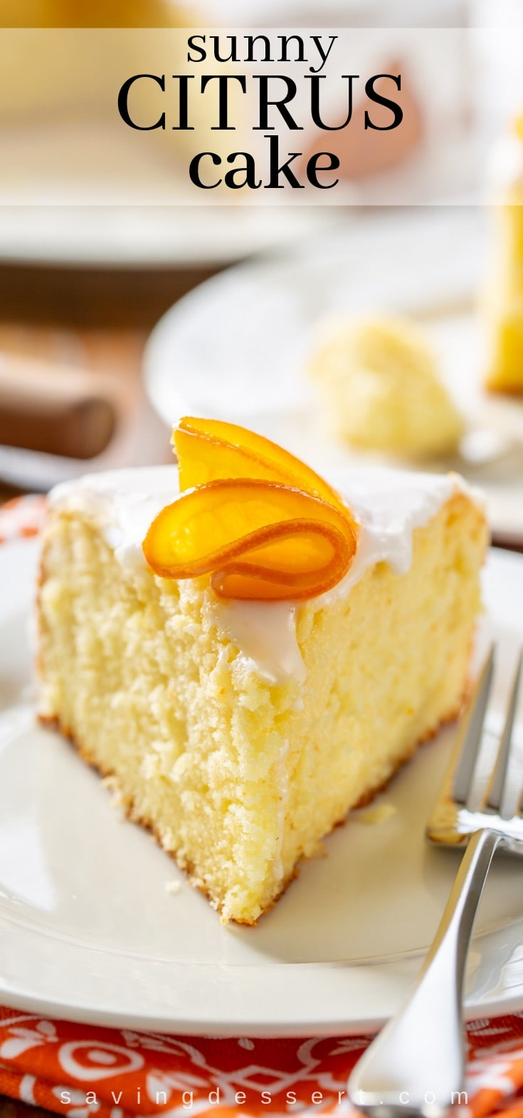 A slice of sunny citrus cake with candied oranges on top