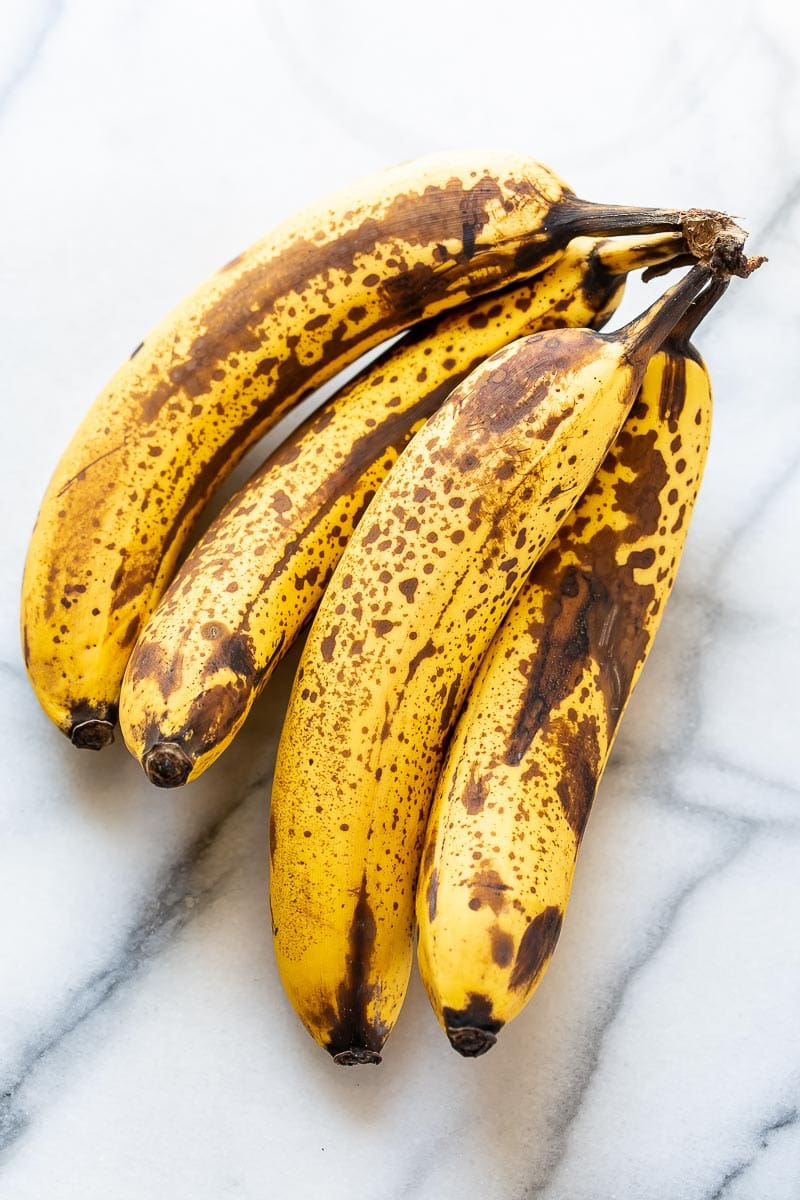 A bunch of ripe bananas on a marble counter top