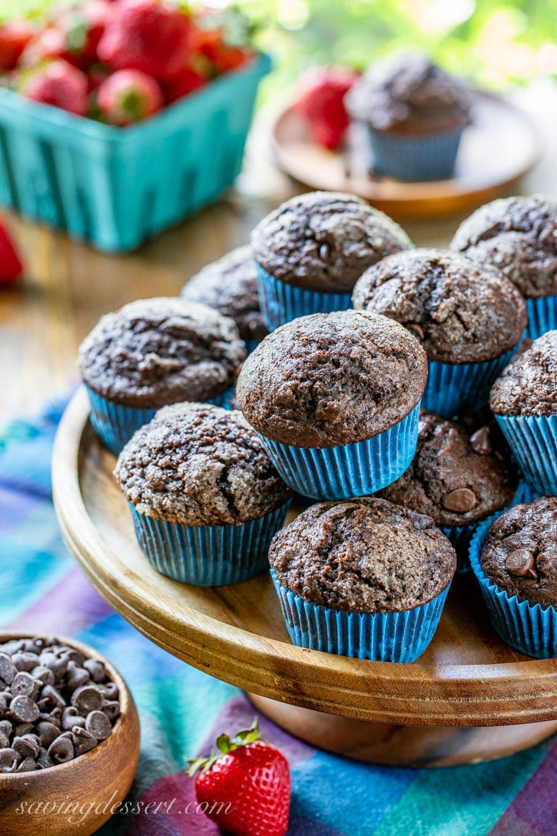 A cake tray filled with dark chocolate muffins with nice rounded top coated with coarse sugar