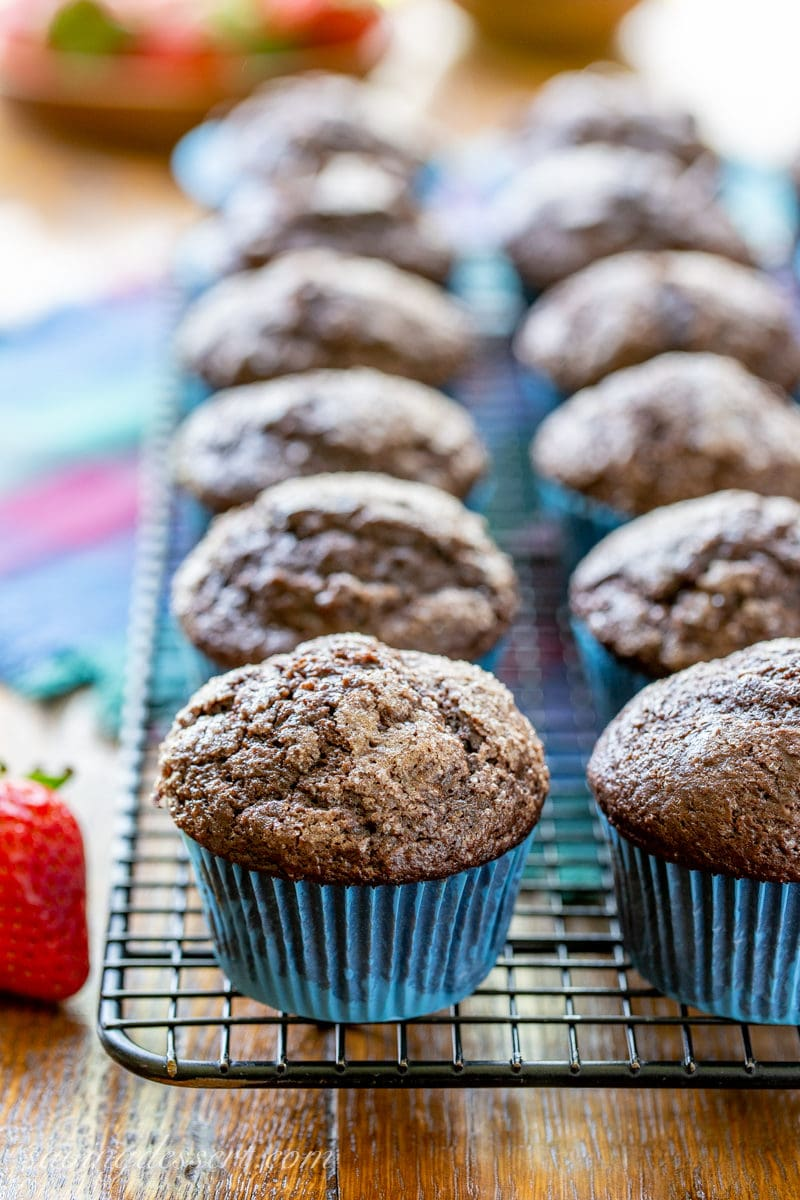 A cooling rack with chocolate muffins