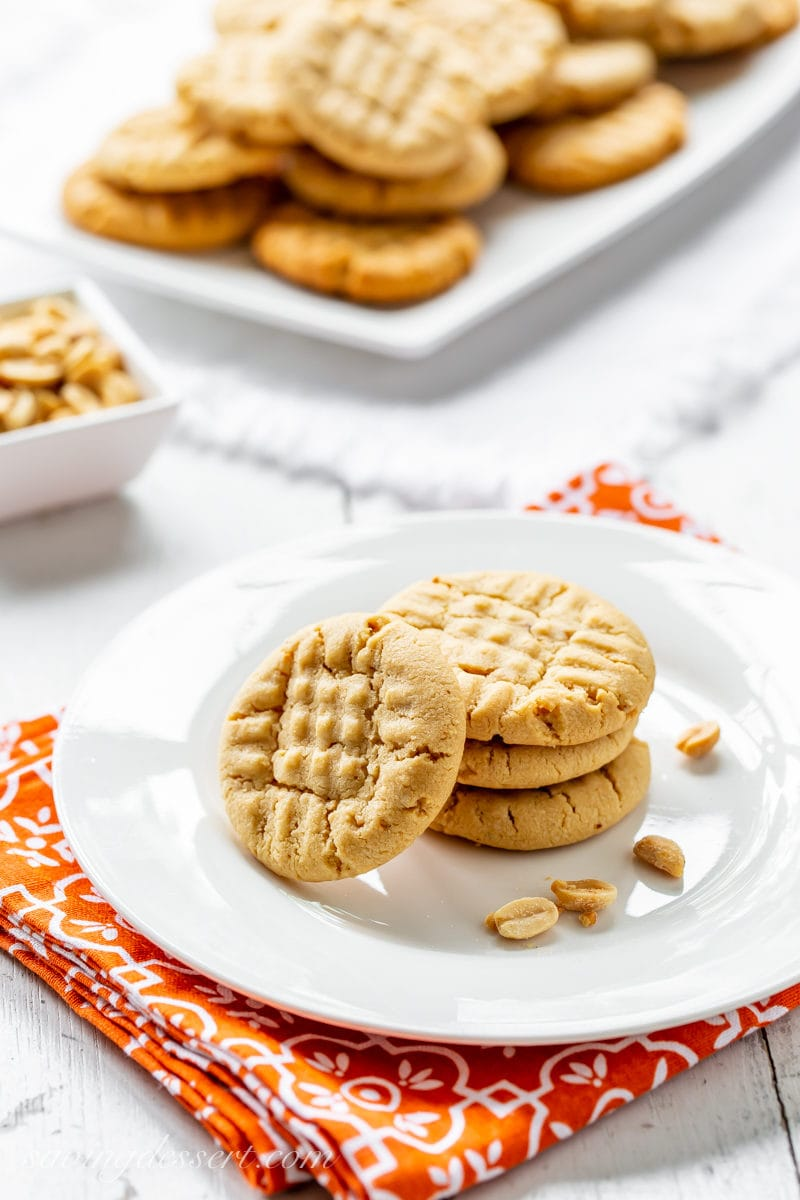A plate of traditional peanut butter cookies with extra peanuts