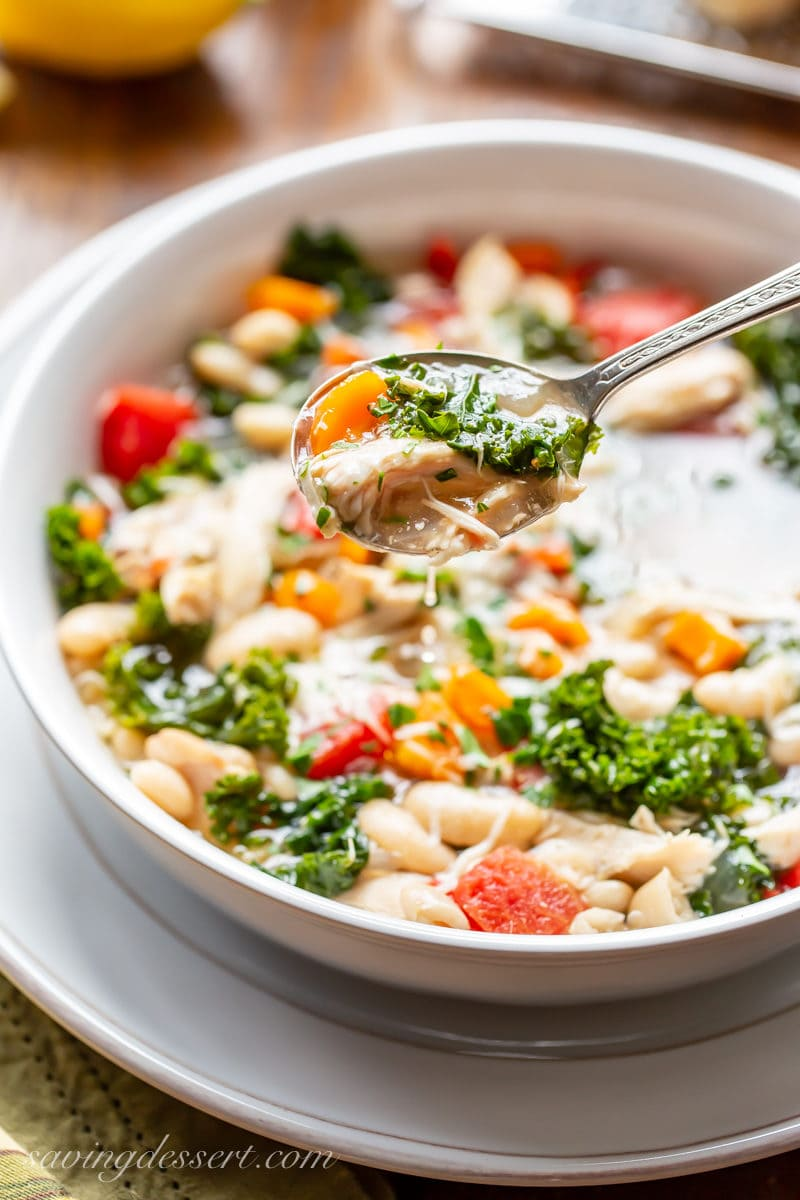 A bowl of slow-cooker chicken and white bean soup with kale
