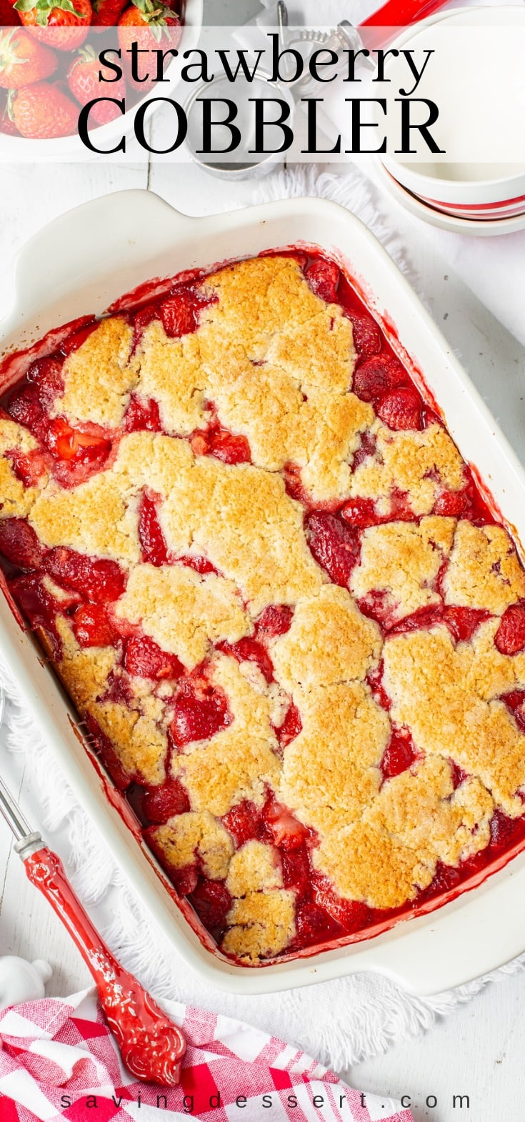 A casserole dish with a juicy strawberry cobbler with sweet crumbled biscuit topping