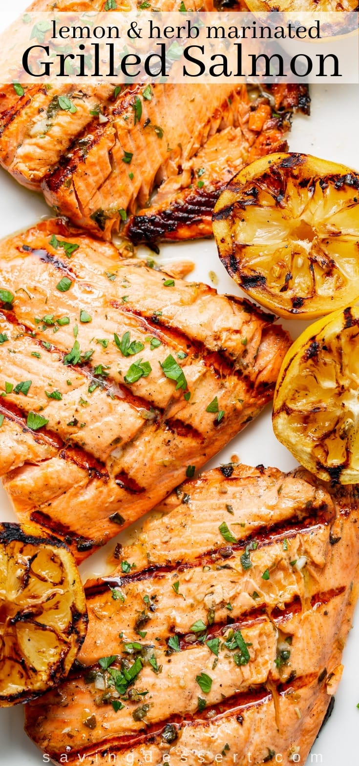 A platter of juicy, grilled salmon fillets with grilled lemon halves