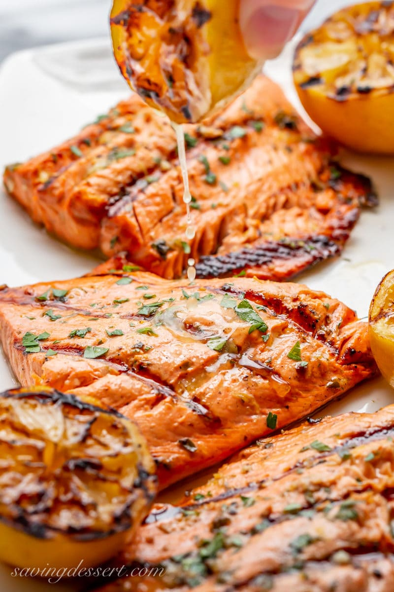 Juicy salmon fillets drizzled with the juices of a grilled lemon