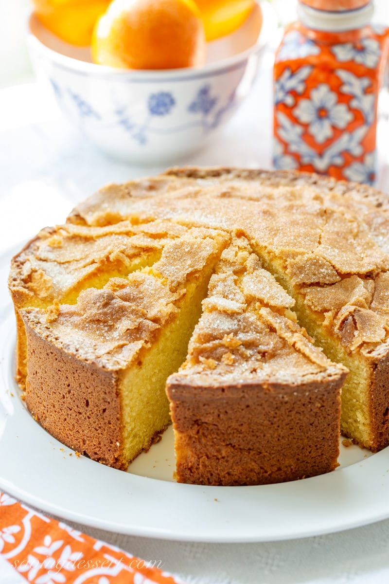 A sliced Orange Olive Oil Cake with a crispy crackly sugar top
