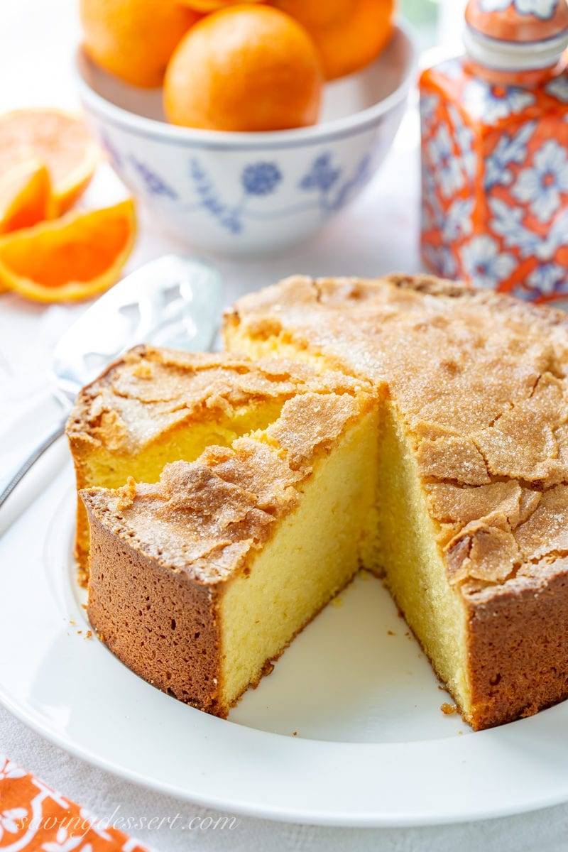 a sliced olive oil orange cake with a crackly top