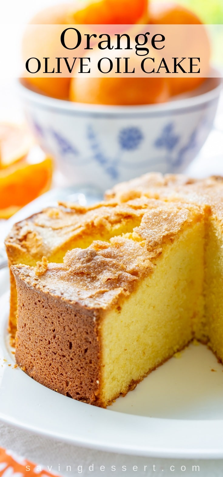 A slice of orange olive oil cake with a crispy crackly top