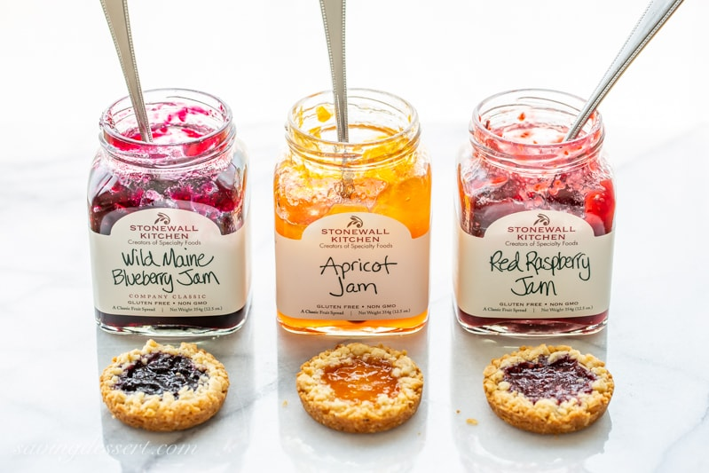 Jars of blueberry, apricot and raspberry jam