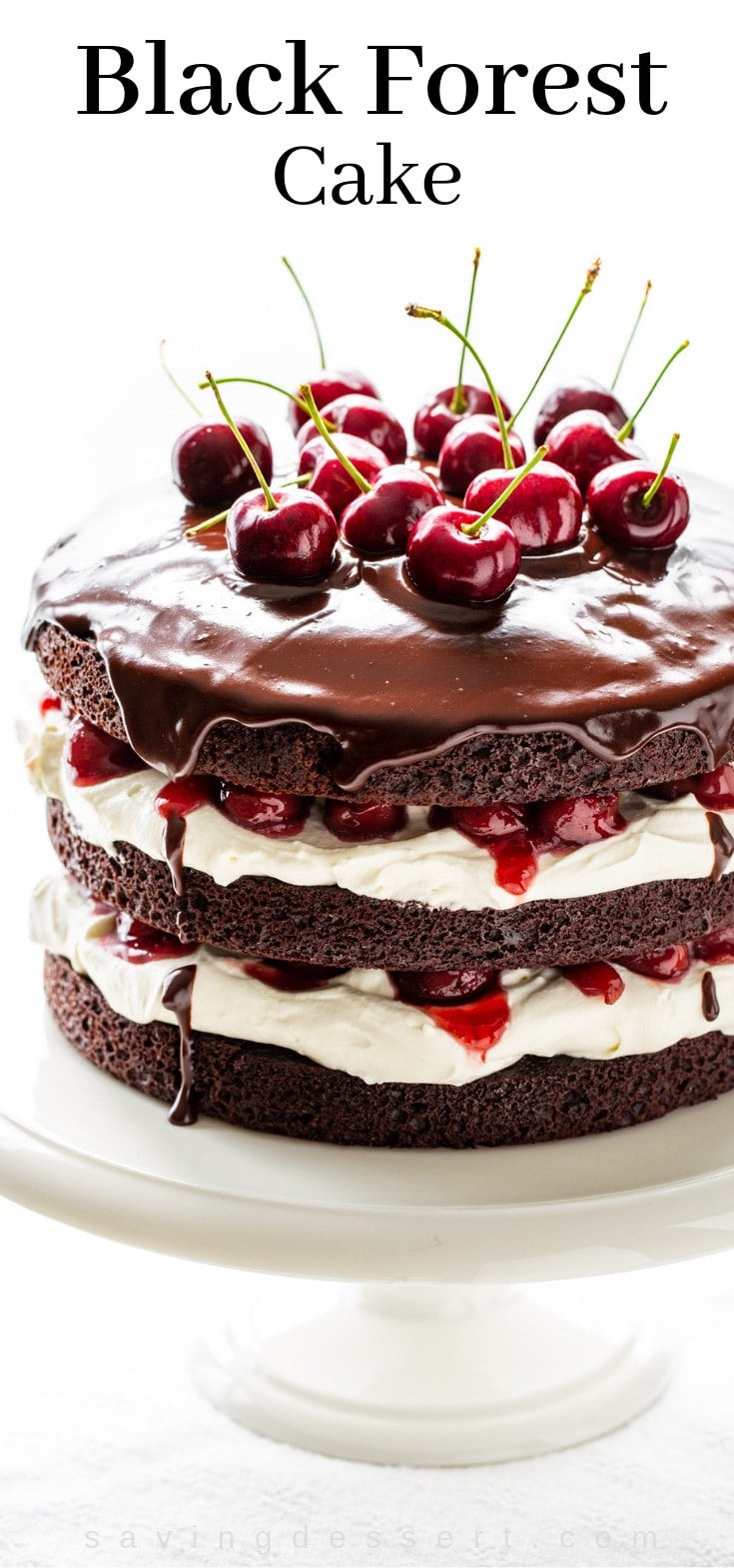 A three layer 'naked' Black Forest Cake topped with a silky chocolate ganache garnished with fresh cherries and a whipped cream filling