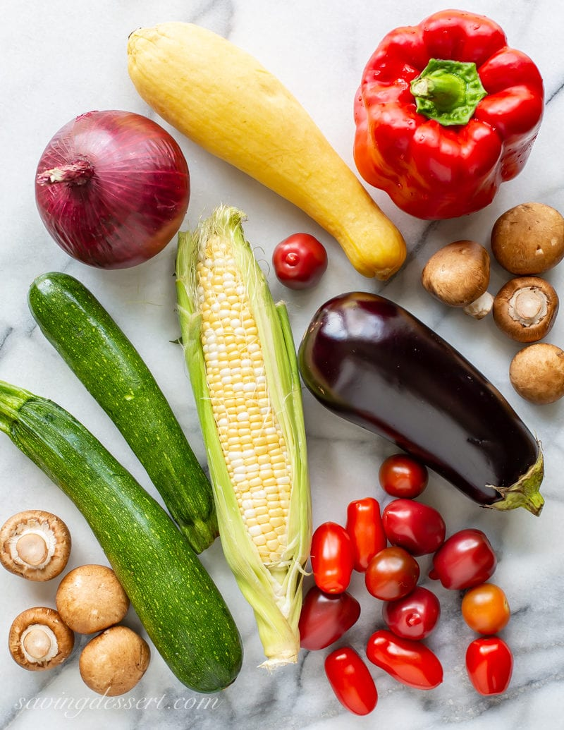 Summer vegetables for grilling: zucchini, mushrooms, onion, bell pepper, eggplant and tomatoes