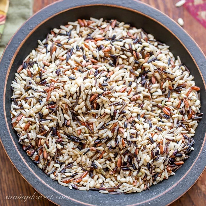 A bowl of uncooked wild rice blend
