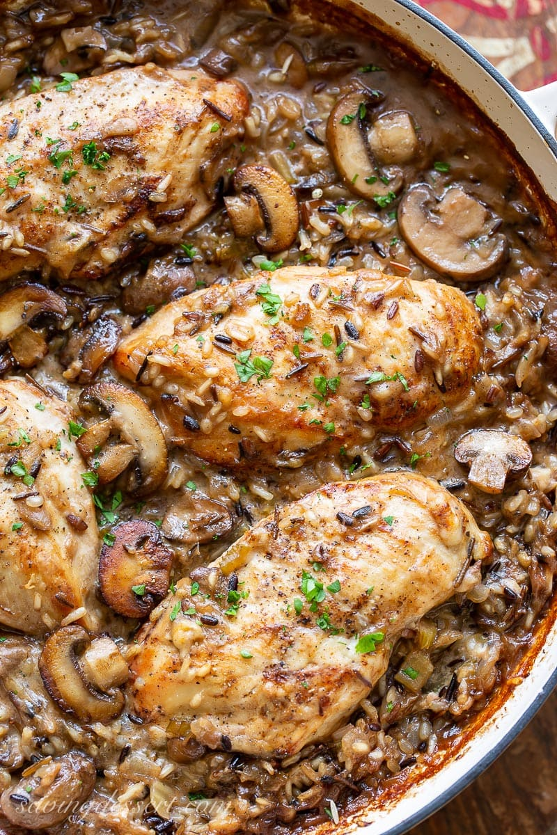 A pan with chicken breasts, wild rice and mushrooms