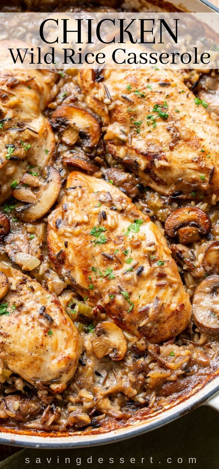A skillet with chicken and mushrooms in a wild rice casserole
