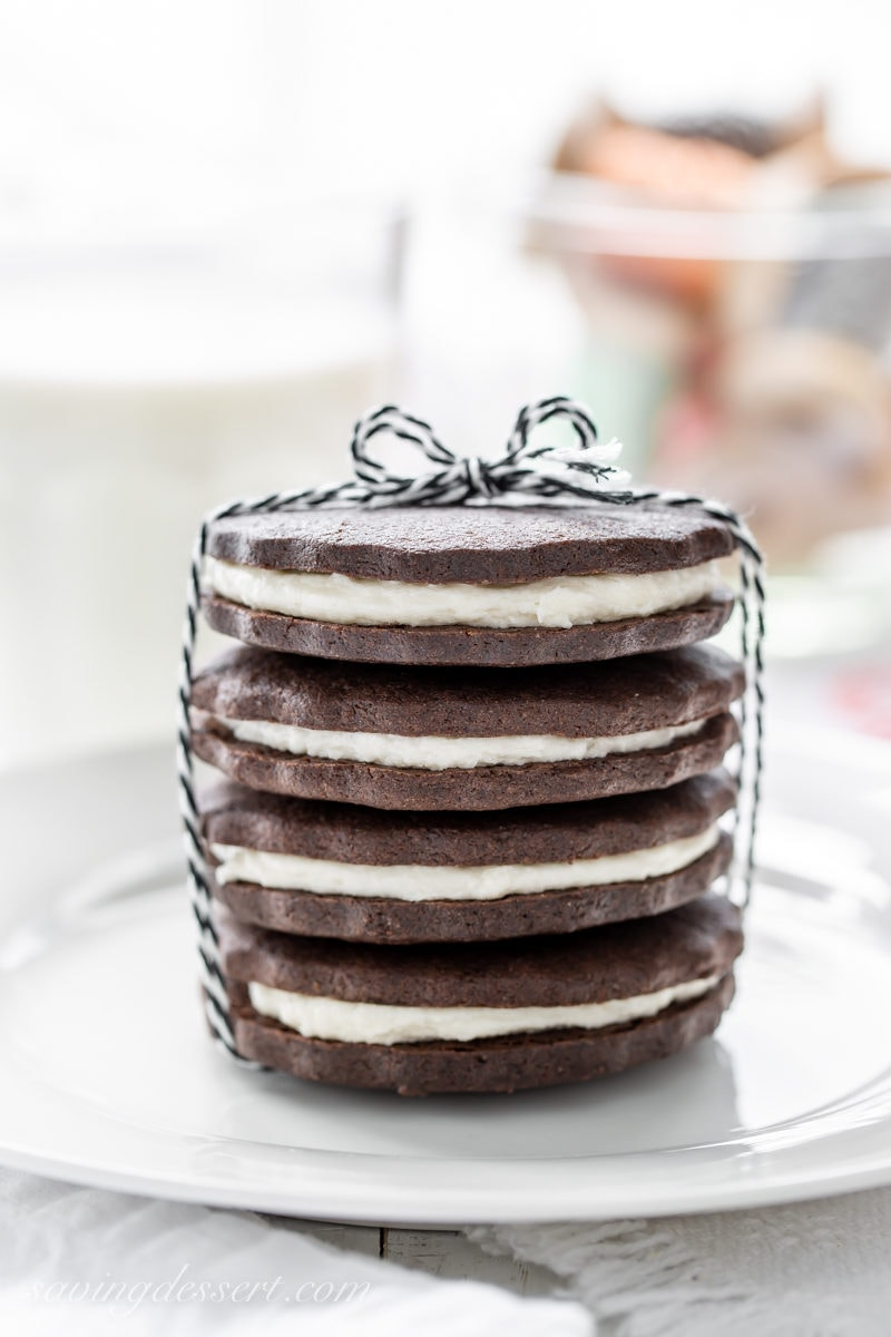 A stack of cream filled chocolate sugar cookies