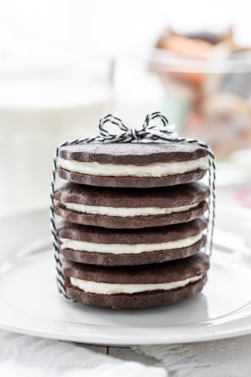 A stack of chocolate sugar cookies with a creamy white filling to look like Oreos