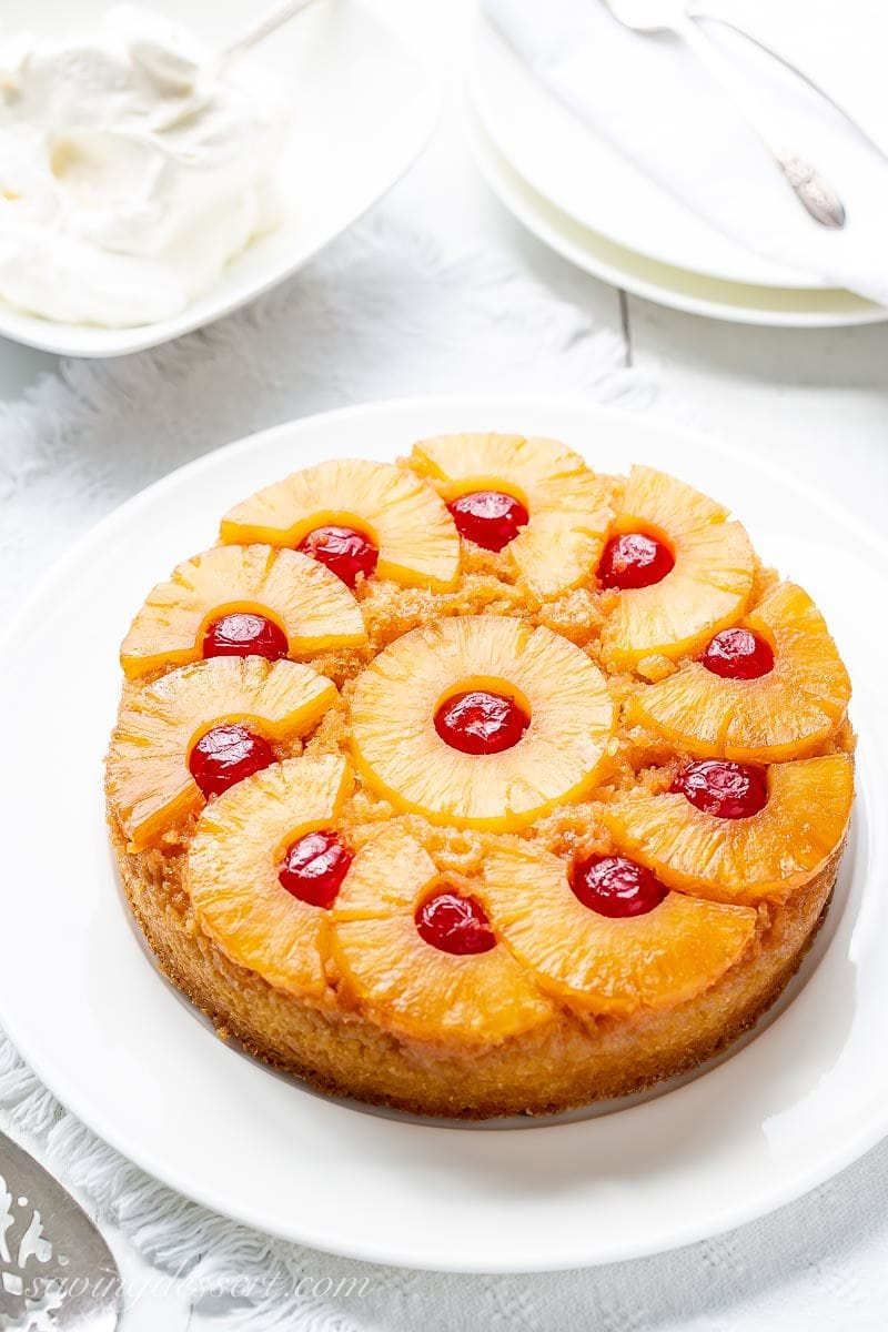 A classic Pineapple Upside-Down Cake with cherries on top