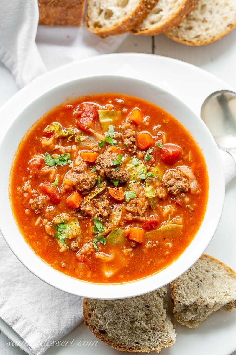 A bowl of beefy Cabbage Roll Soup with carrots, tomatoes and rice