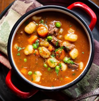 A bowl of hearty beef and gnocchi soup