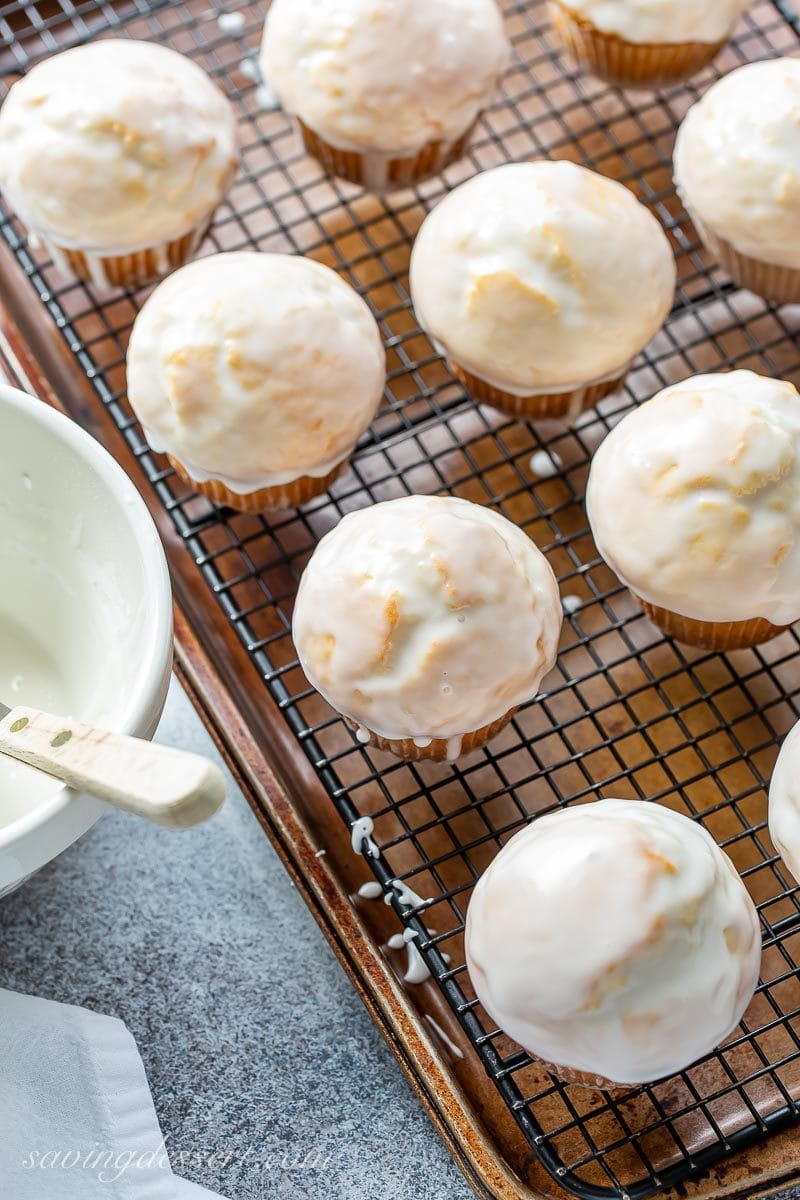 An overhead shot of donut muffins on a cooling rack with a simple vanilla glaze