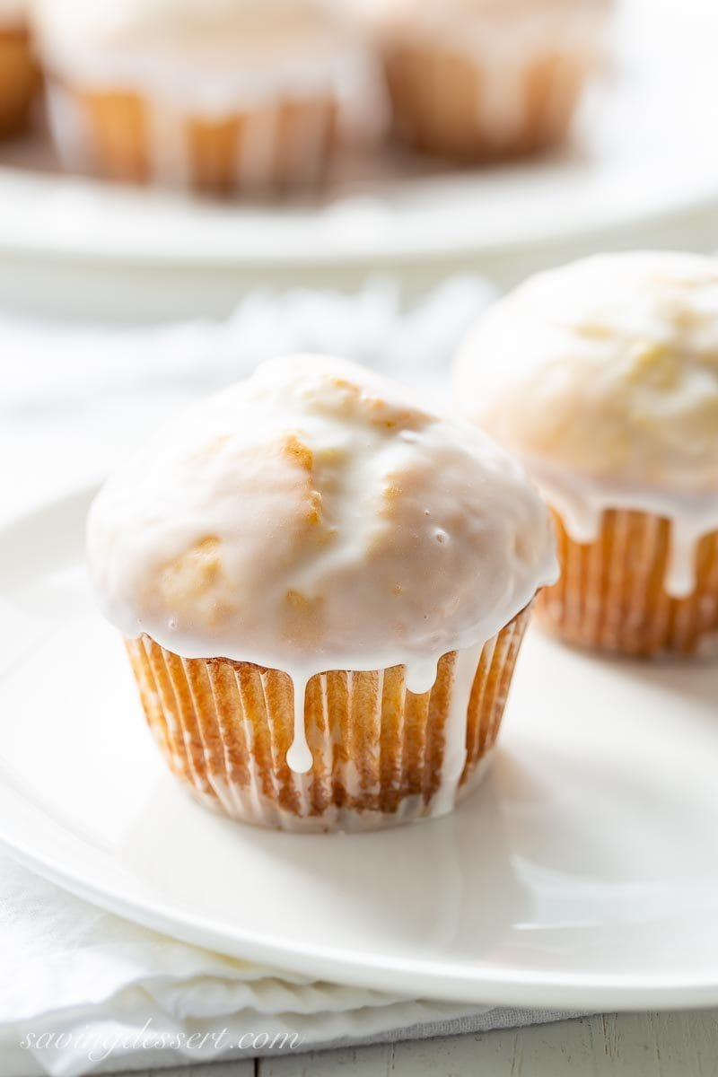 Old Fashioned Donut Muffins on a plate with a drip of icing on the side