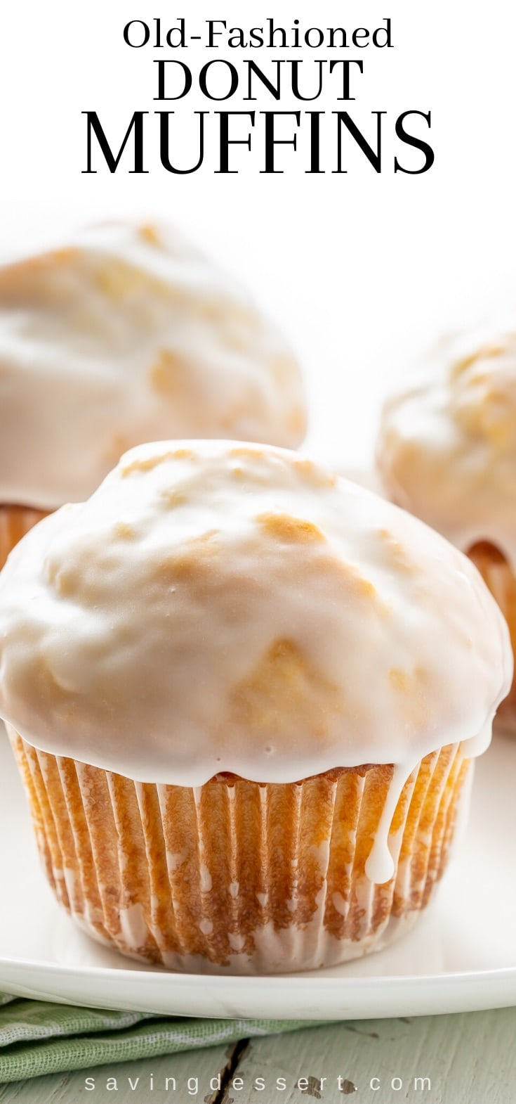 Old fashioned donut muffins on a plate with a drip of vanilla glaze on the side