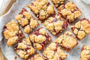 A tray of peanut butter and jelly bars cut into squares