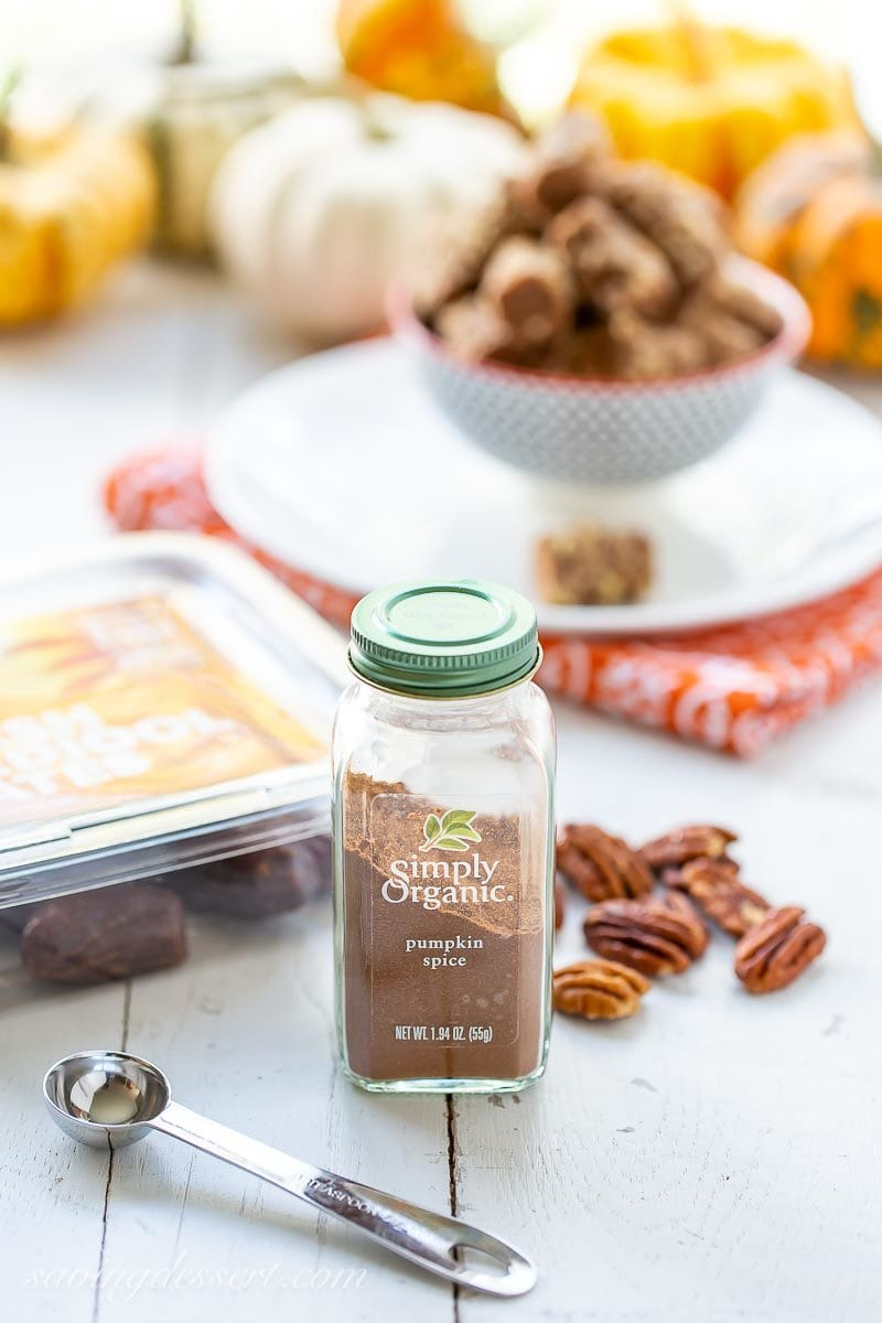 A bottle of pumpkin spice with pecans, Medjool dates and date nut rolls