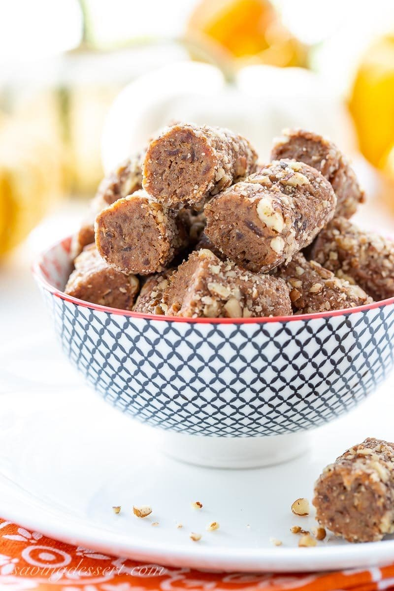 A bowl of pecan covered pumpkin pie spiced date rolls