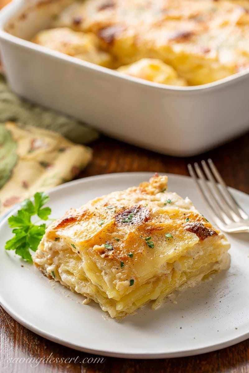 A big scoop of Au Gratin potatoes lightly browned on top garnished with parsley
