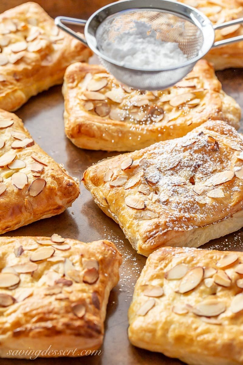 Baked puff pastry tarts sprinkled with powdered sugar