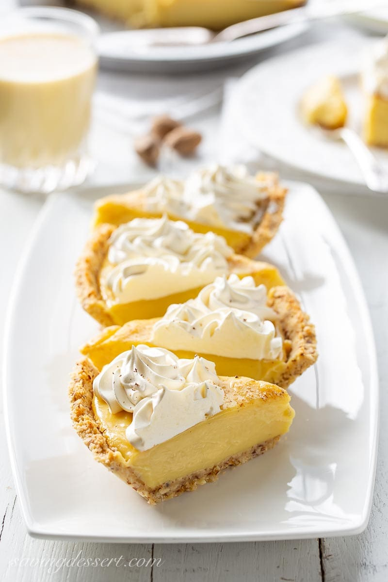 Slices of eggnog pie topped with whipped cream