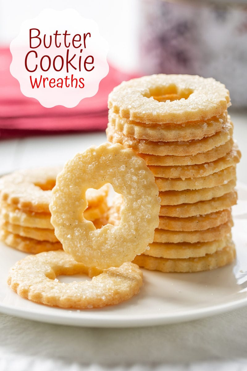 A stack of butter cookie wreaths on a plate