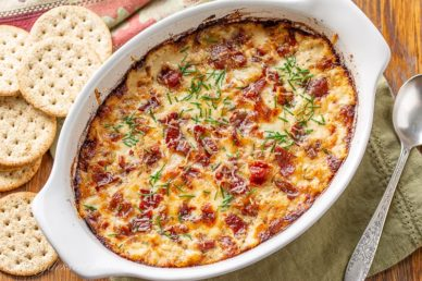 A small casserole dish with hot caramelized onion dip