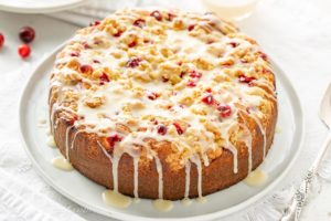 Orange Cranberry cake with a crumble top drizzled with a simple icing
