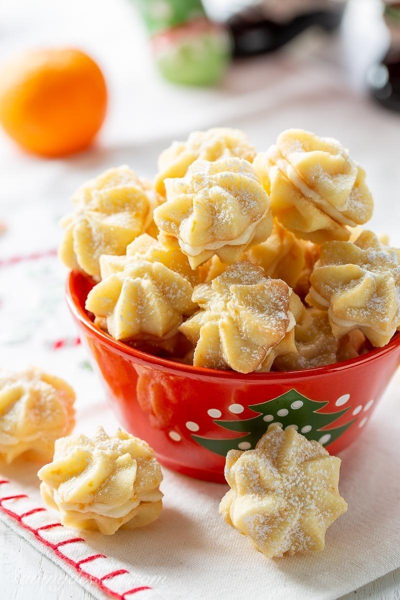 A bowl of orange cream star cookies