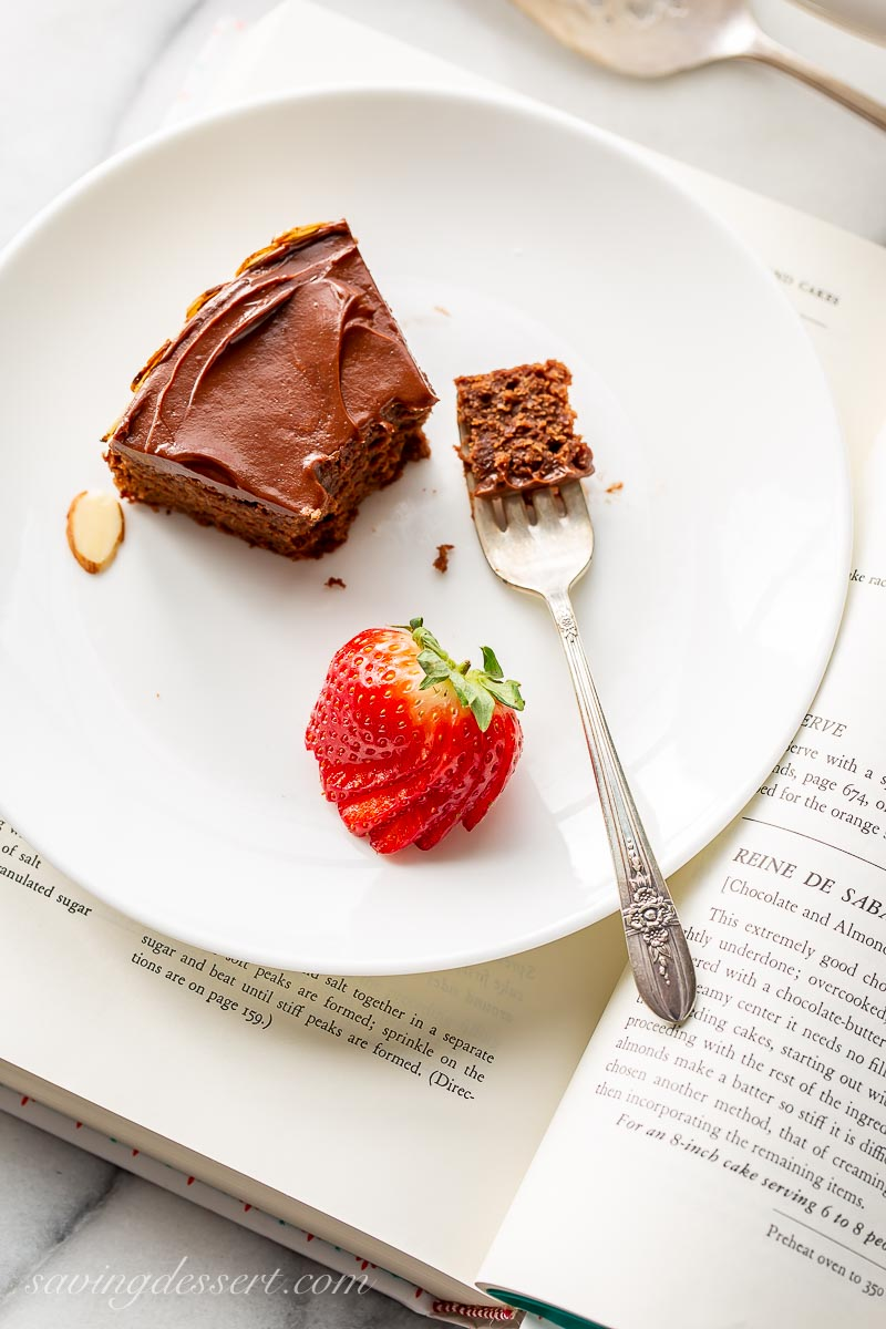 A slice of chocolate almond cake with strawberries