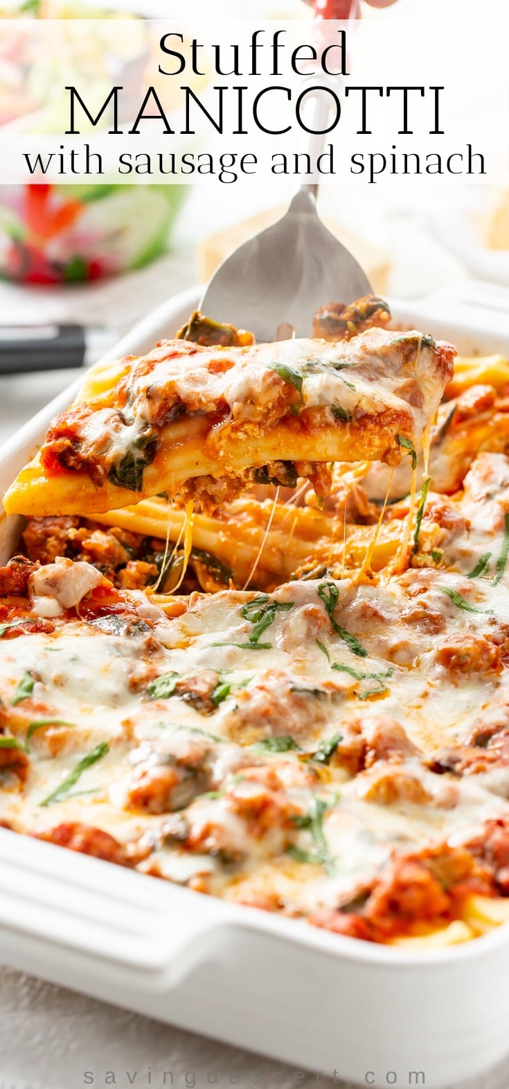 A casserole with stuff manicotti covered in cheese