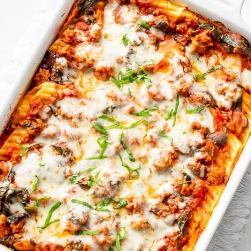 Stuffed Manicotti with sausage and spinach in a casserole dish