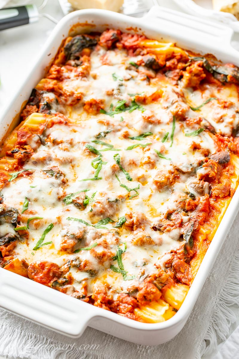A casserole dish with meaty stuffed manicotti with spinach