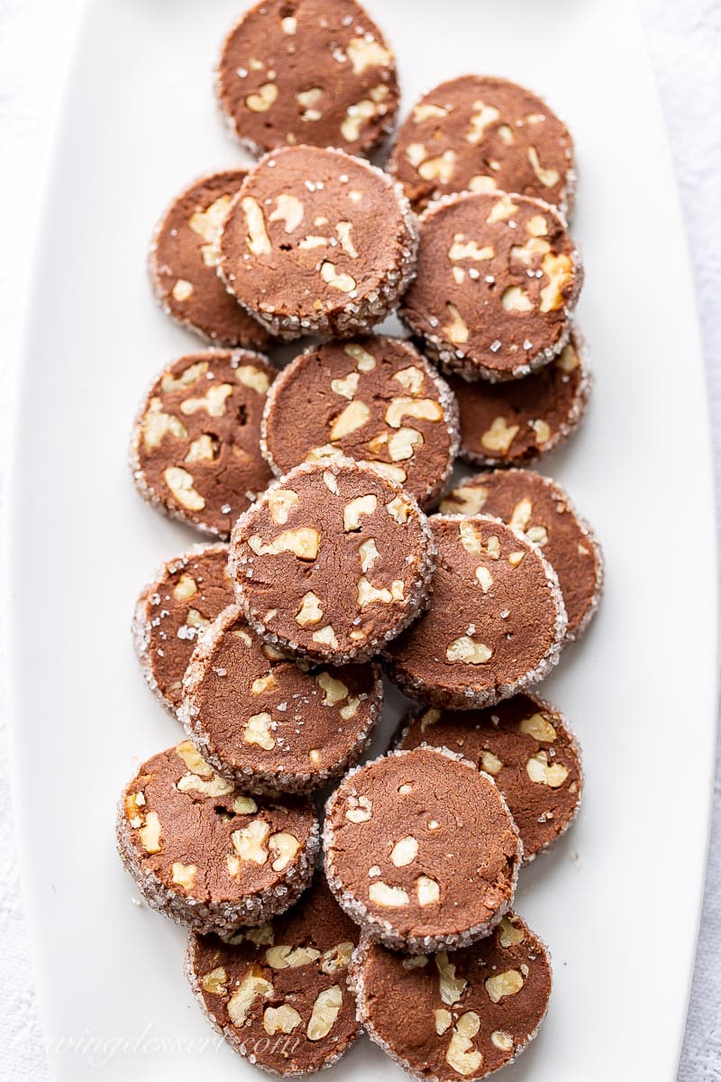 A platter of chocolate shortbread cookies with walnuts