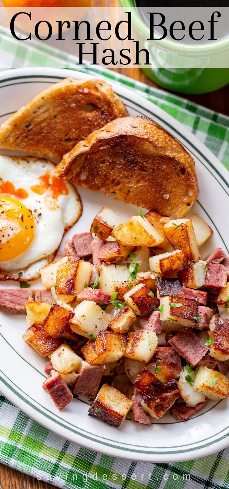 An overhead view of a plate of corned beef hash with an egg and toast