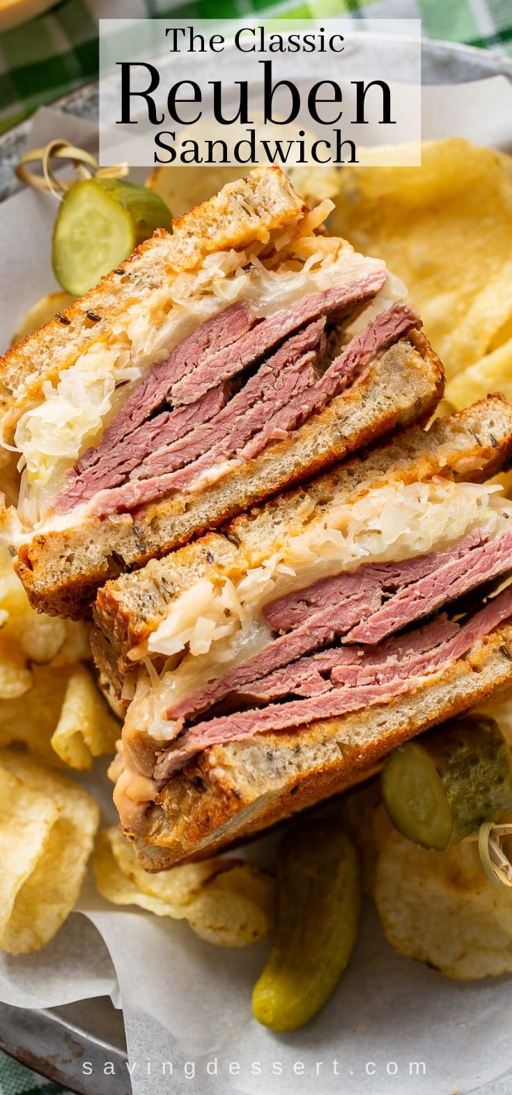 A close up of a Reuben sandwich served with chips