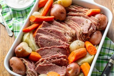 A casserole dish filled with slow-cooker corned beef and cabbage