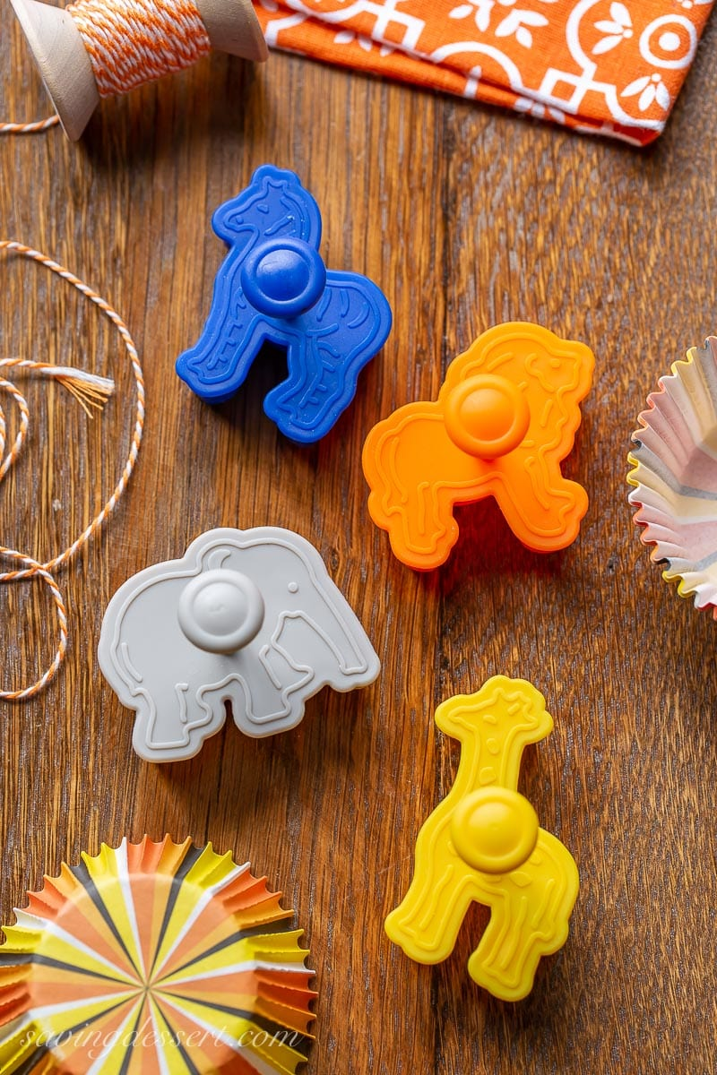 An overhead view of 4 zoo animal cookie stamps